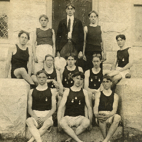 The 1902 track team wearing their medals