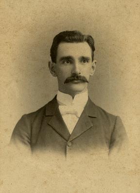 Principal Charles Alden Tracy, 1893 senior class portrait.