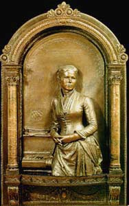 Bronze relief of his wife Louise by Augustus Saint-Gaudens (1884).