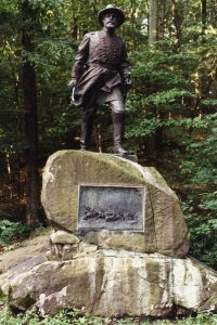 his statue located in Gettysbury, PA, with bas-relief below representing four companies of the 1st Vermont Cavalry in the battle