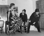 "Scenes from Love Rides the Rails, an ""old-fashioned melodrama"" with musical numbers performed by an all-male cast in the Meriden Town Hall during Dad's Weekend and three weeks later during Mother's Weekend in 1947."