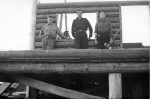 Wayland Porter, faculty (1935-1965), Frederick Walker '39 and Andrew Nealley '40, Outing Club members, constructing the cabin.
