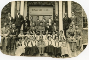 "Ninety years ago, the class of 1924 had their photograph taken on the familiar Baxter Hall steps. The young man prominently sitting with all the women is William Kellett. In their yearbook, the editor said of him, ""Jill is a man of varied talents; good in his studies, a king of syncopation, and also appears to make some headway with the ladies. We don't think they take him seriously, but that isn't important, says Jill. ..."""