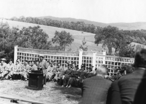 In this 1937 Commencement photograph, KUA's herd of cows can be seen grazing on the Potato Patch. Senior C. Parker Jones, is at the podium given by the Class of 1902 and one that is used to this day for all assemblies including Commencement.