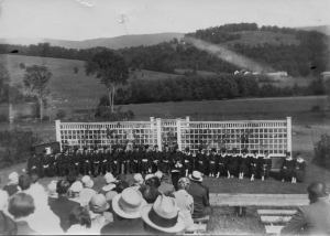 This photograph, c. 1920, was taken at a Commencement held at the Howard Emerson Merrill Amphitheatre on Chellis Road. The Class of 1920 endowed a prize that was first given eight years after they graduated in 1928. The original prize was $5.00.