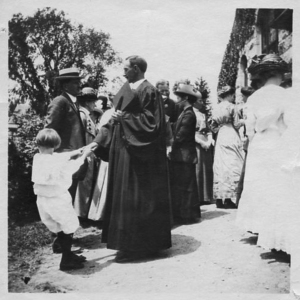 This touching photograph, c. 1910, of Headmaster Tracy with his young son, greeting family gathered outside the Stone Church at Commencement, is representative of the many responsibilities of KUA's faculty as home and school become one.