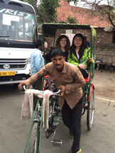 Brittany Kainen and Kathy He enjoy a ride in a cycle rickshaw
